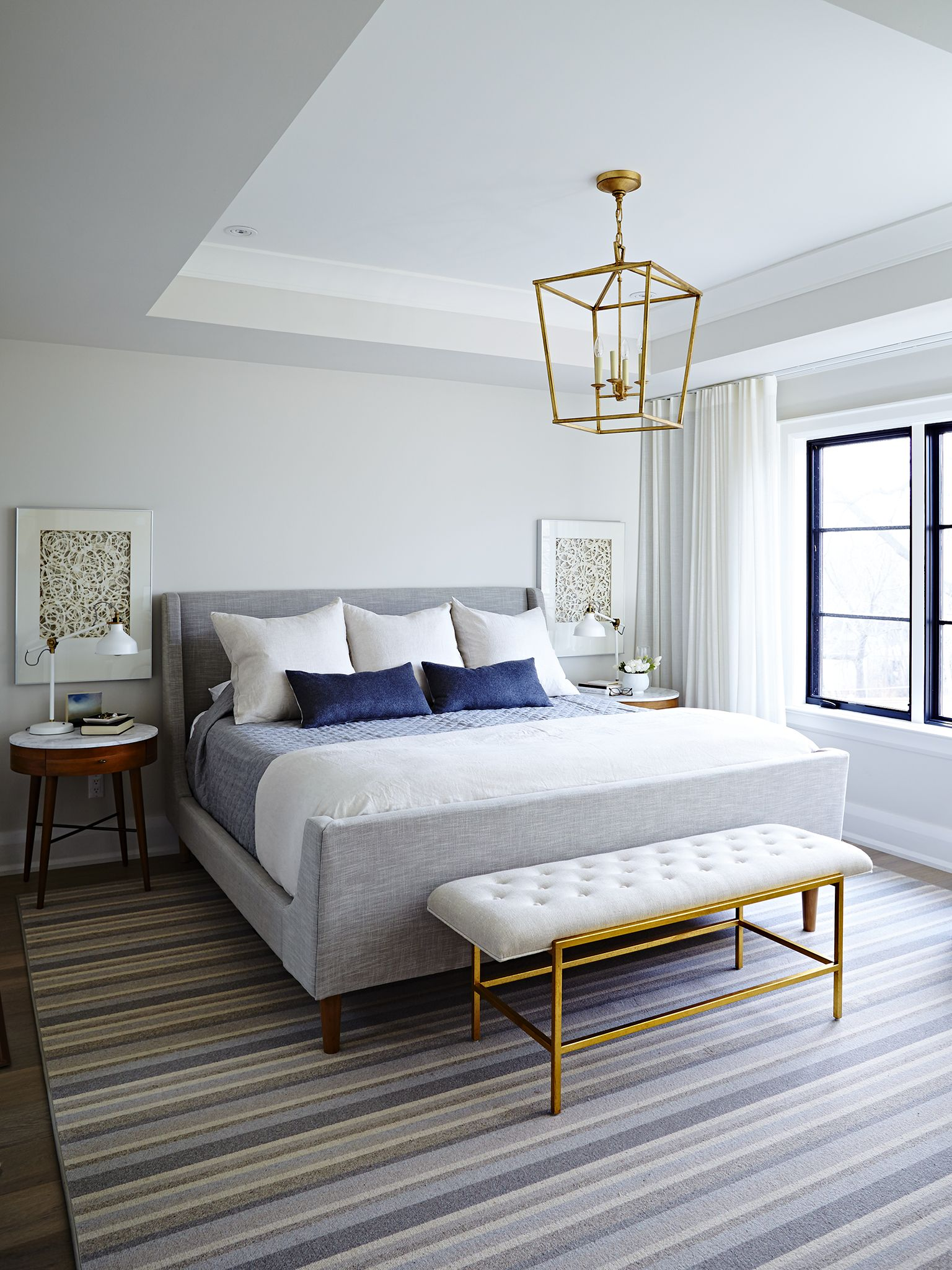 Master bedroom with lofted ceiling and gold accent hanging light ...