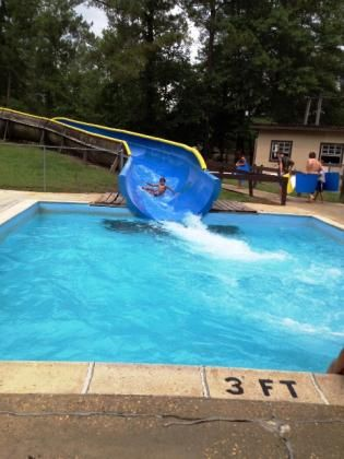 Land-O-Pines Family Campground Inc | Pool, water slide, creek with natural sandy beaches, fishing ponds, mini-golf, game room, play ground, horseshoe pits, soft ball field, volleyball net, basketball court. #Louisiana