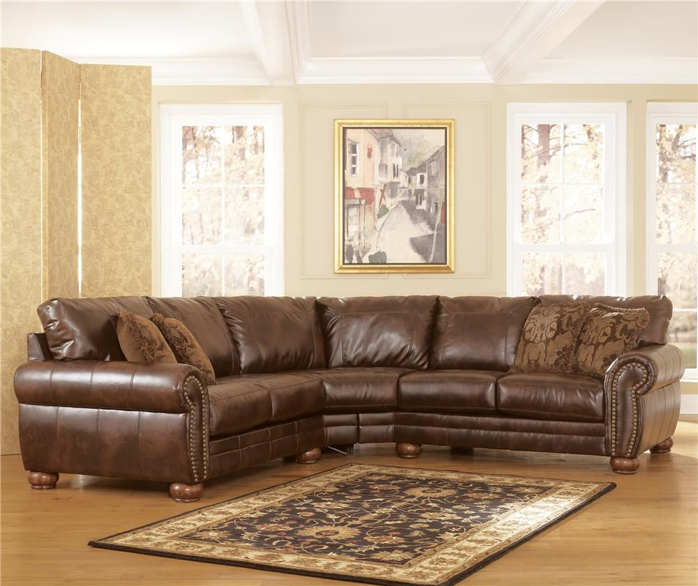 Durablend Antique Sectional With Rolled Arms And Wood Bun Feet