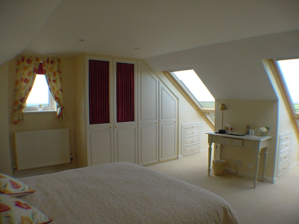 Loft bedroom with ensuite  A bungalow loft conversation to create a master bedroom with storage