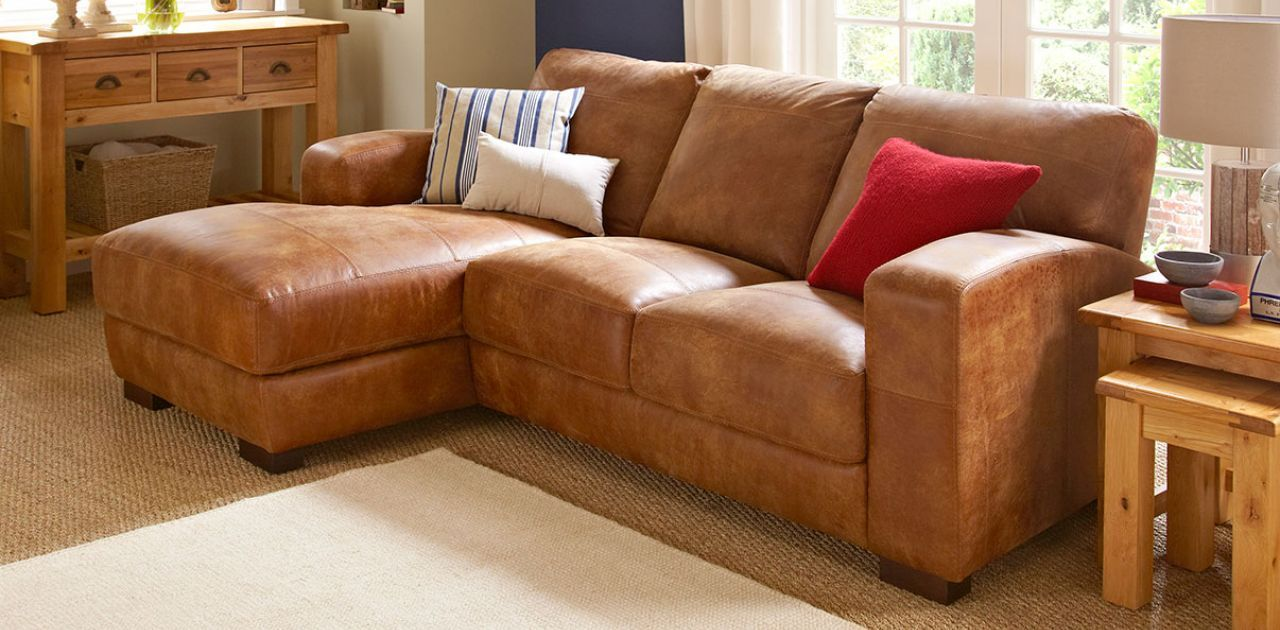 flanking size high sectional beautiful furniture beside with in leather upscale the full frame tufted tan of living sofa blankets end for room fireplace a couch bourbon hardwood baskets