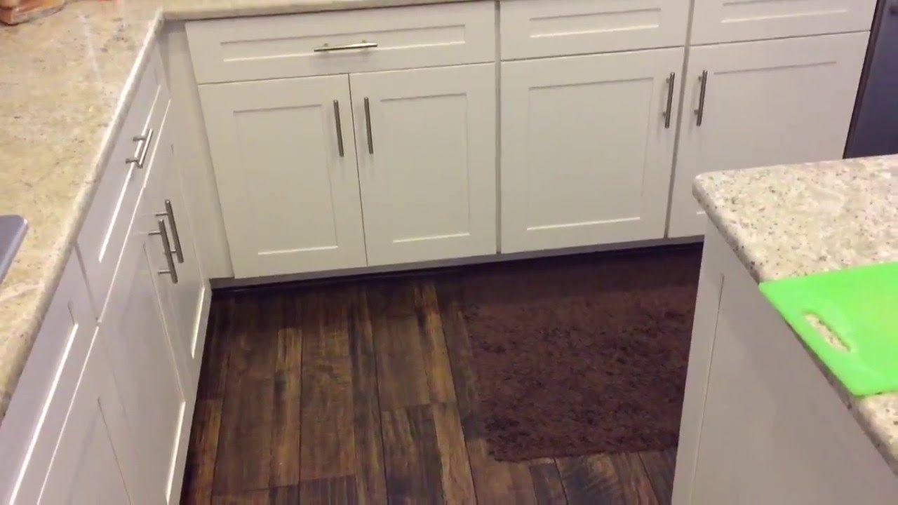 Installing Laminate Flooring In Kitchen Under The Cabinets Kitchen Ideas Laminate Flooring In Kitchen Wooden Kitchen Floor Wood Floor Kitchen