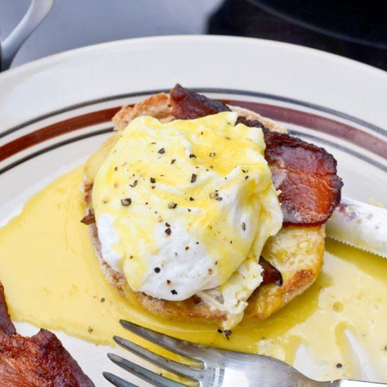 The perfect breakfast for a lazy Sunday: buttery, creamy eggs benedict over crispy smoked bacon on a whole wheat  English muffin.  Heaven.
