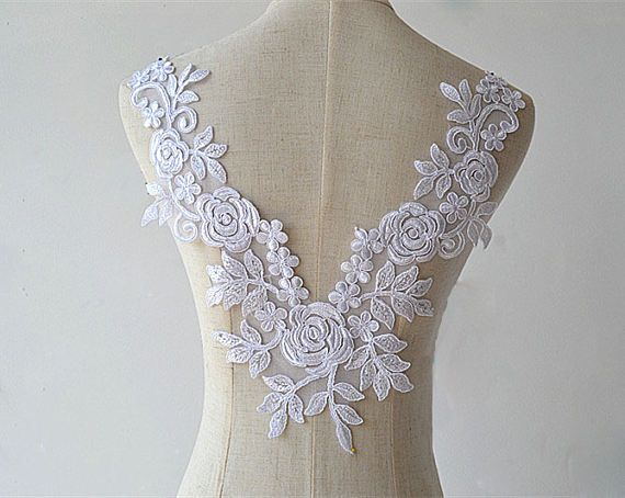 White lace flower applique with a d center flower and leaves