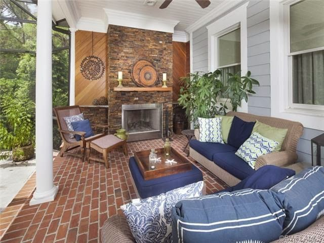 Lanai That Lives Like A Living Room Brick Fireplace Naples Fl