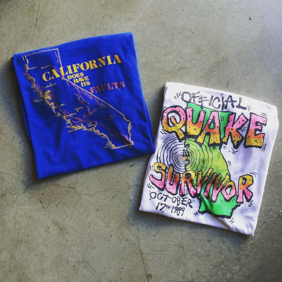"What's shakin' San Francisco? Come on thru and take a break from all that Pokemon go! ""California does have its faults"" t shirt labeled size large measures 20"" pit to pit and 29"" neck to hem. $35+$8 domestic shipping. ""Official quake survivor"" t shirt measures 21"" pit to pit and 29"" neck to hem. $36+$8 domestic shipping. To purchase call 415-796-2398 or PayPal afterlifeboutique@gmail.com and reference the item in post."