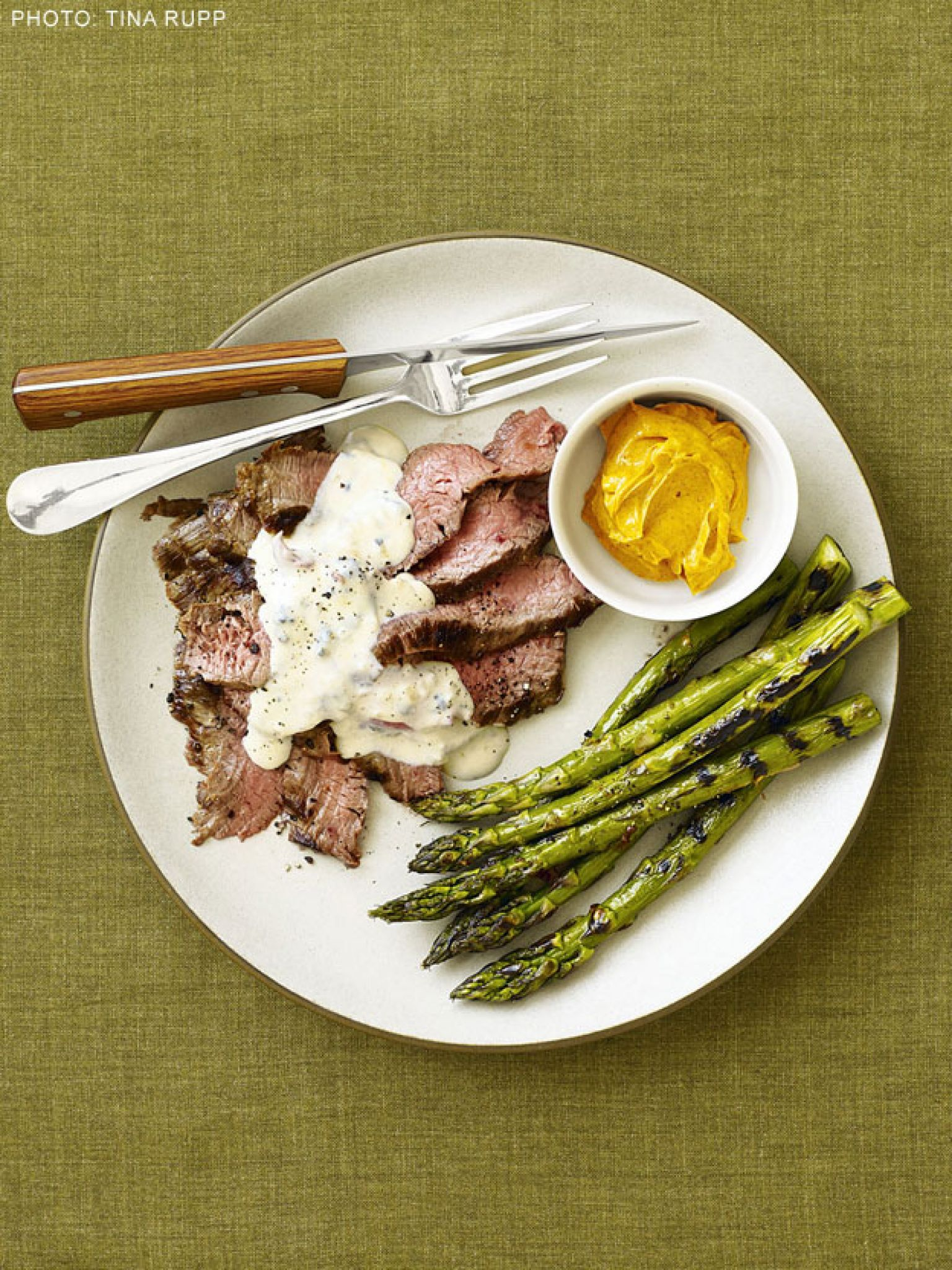 Grilled Flank Steak with Gorgonzola Cream Sauce and Asparagus recipe from Patrick and Gina Neely via Food Network