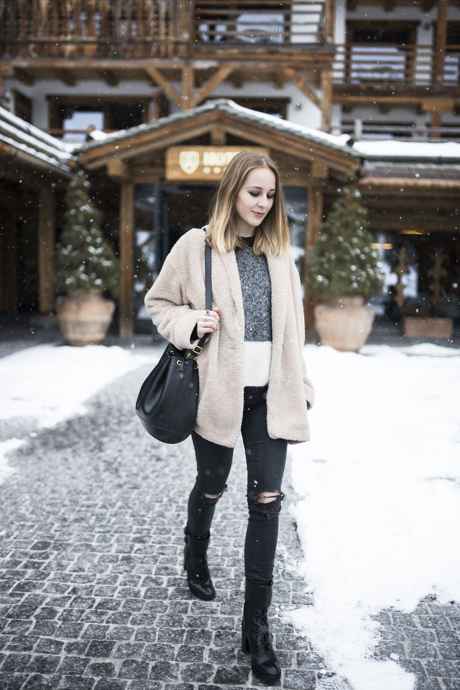 30 Ways to Look Stylish in the Dead of Winter - cropped grey sweater, ripped black skinny jeans + black ankle boots and a beige teddy coat