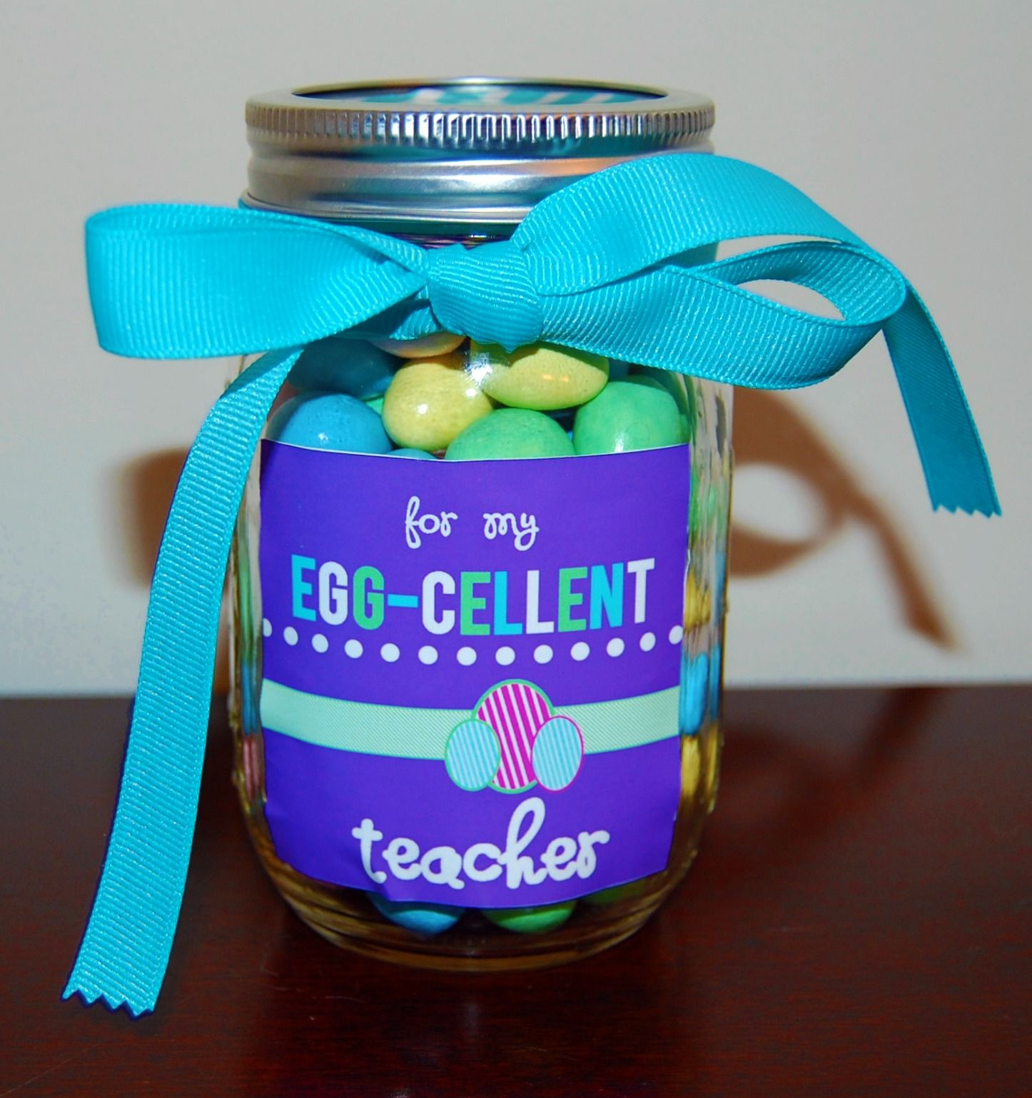 Whos ready for a super cute teacher gift this girl since this is free easter teacher gift printable heres an adorable teacher gift idea for easter fill a jar with egg shaped candies and put on this for my egg cellent negle Image collections