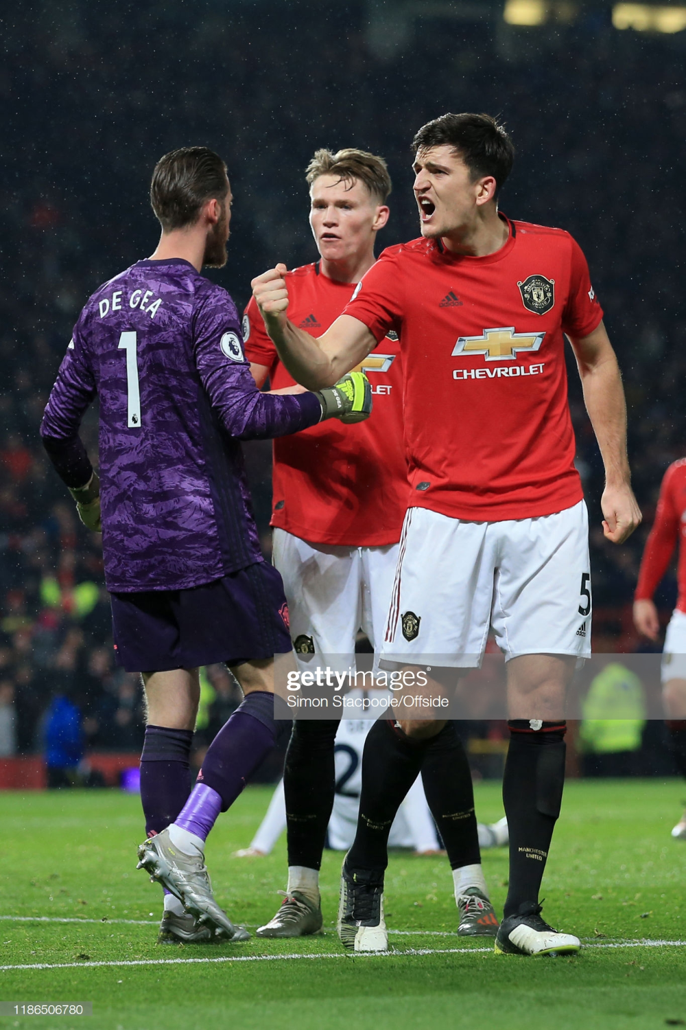 Harry Maguire Of Man Utd Celebrates Victory Along With Man Utd Manchester United Team Premier League Matches Manchester United