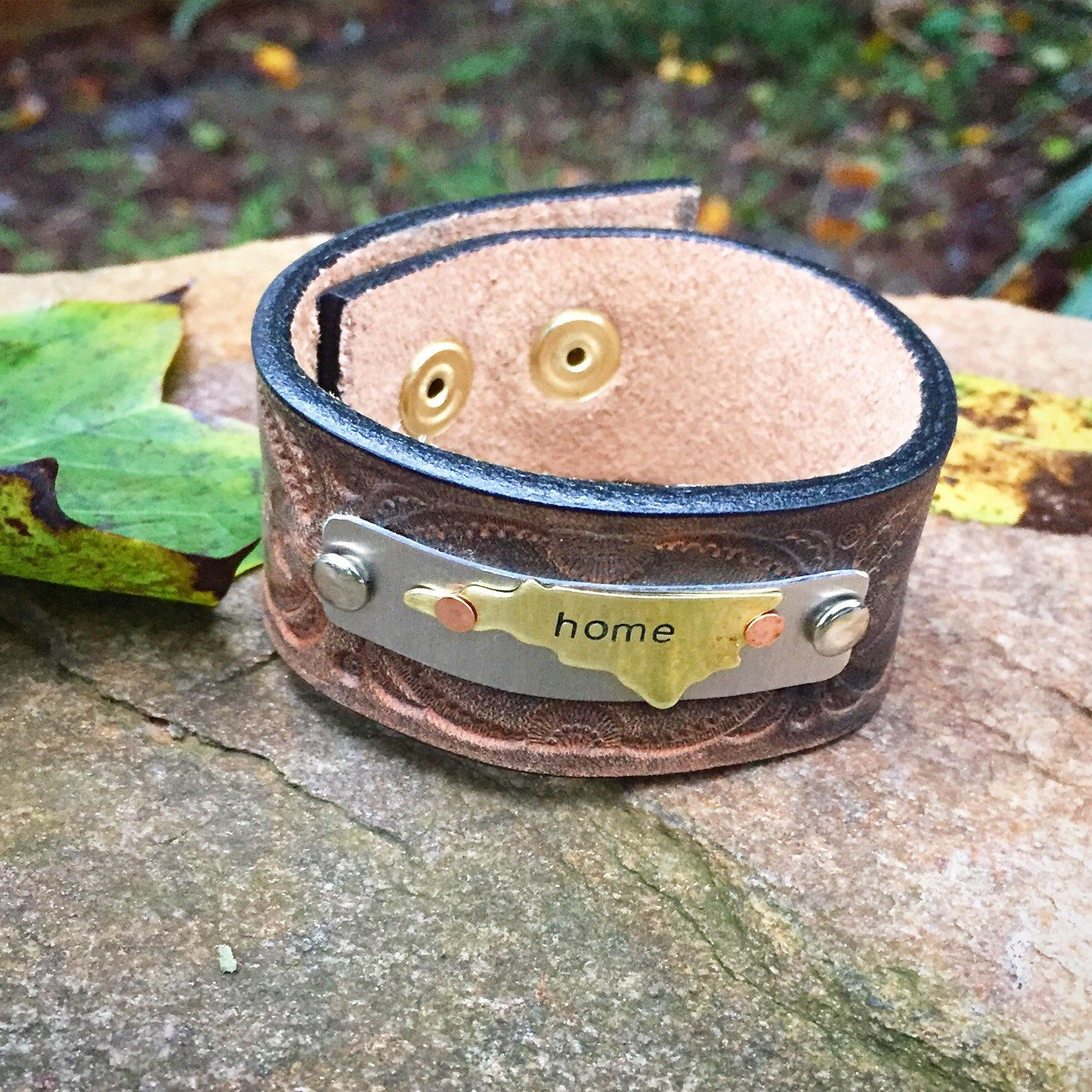 """Handcrafted stamped metal leather North Carolina """"home"""" cuff bracelet by WildArrowStudio on Etsy https://www.etsy.com/listing/250455461/handcrafted-stamped-metal-leather-north"""