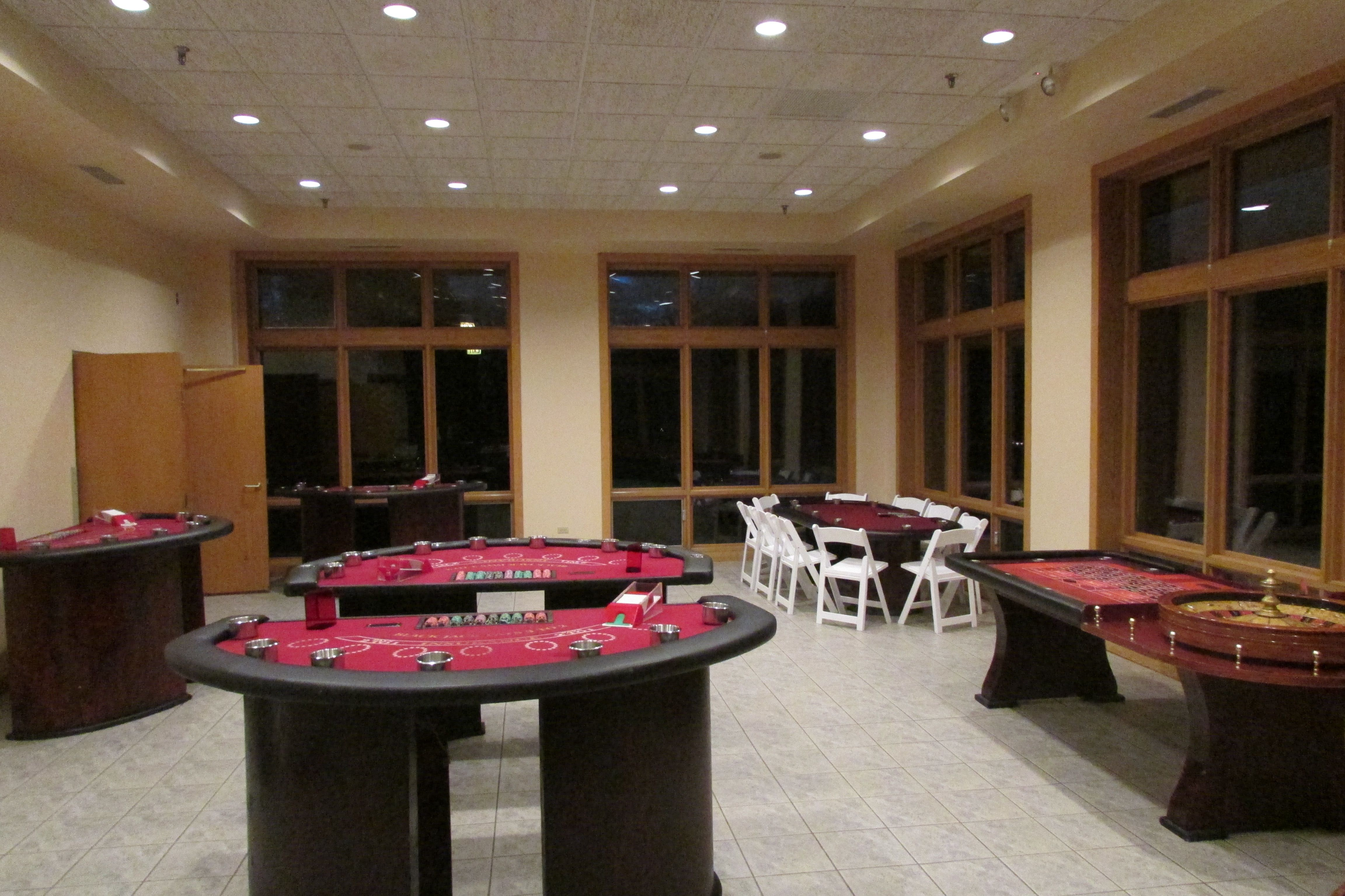 Casino themed bridal shower. Roulette, craps, poker and other casino games were brought in and set up in the back room to make for an event guests really enjoyed.
