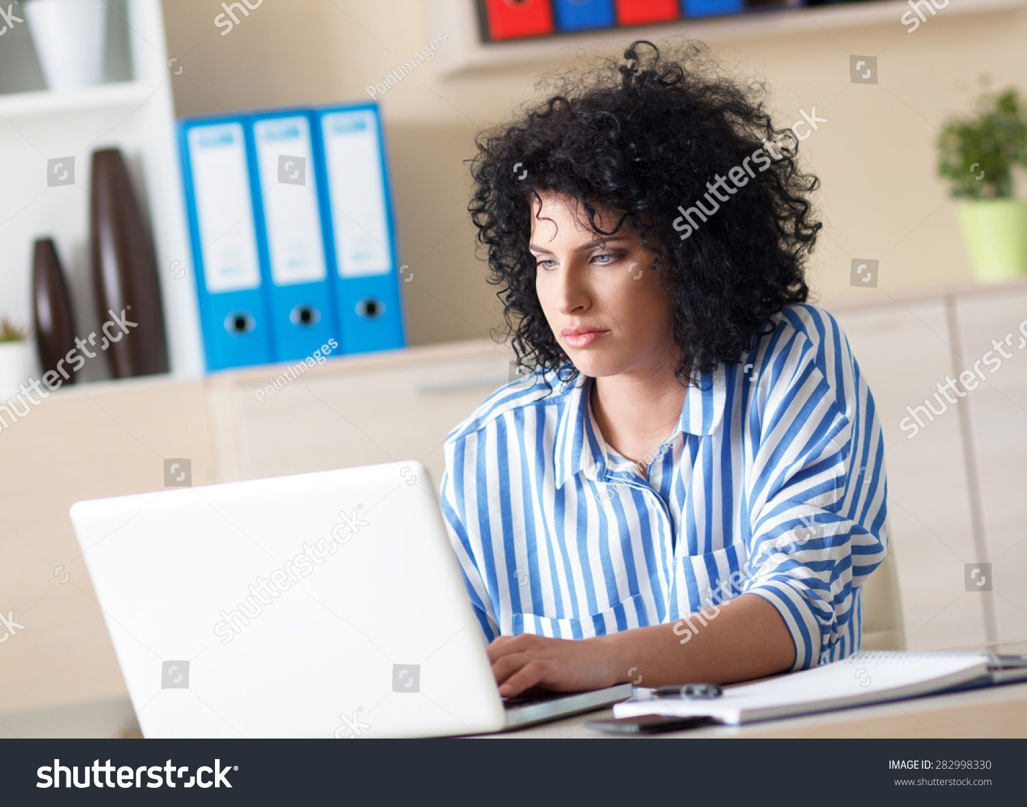 Attractive young female working in office, She typing on laptop #Ad , #Sponsored, #female#young#Attractive#working