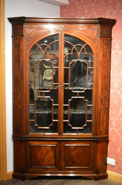 View this item and discover similar corner cupboards for sale at - A  mahogany George III Period Chippendale inspired double corner cabinet. - A Mahogany George III Period Chippendale Inspired Double Corner