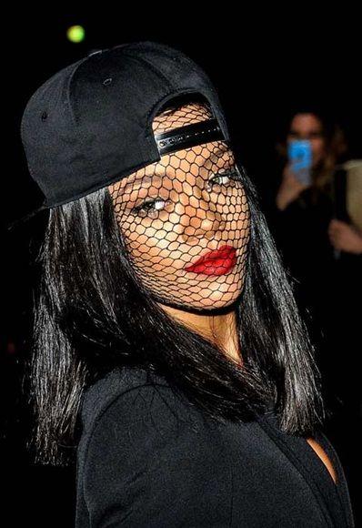 ea57077036c66 Rihanna wearing a snapback cap and mesh at Givenchy AW14 show at Paris  Fashion Week