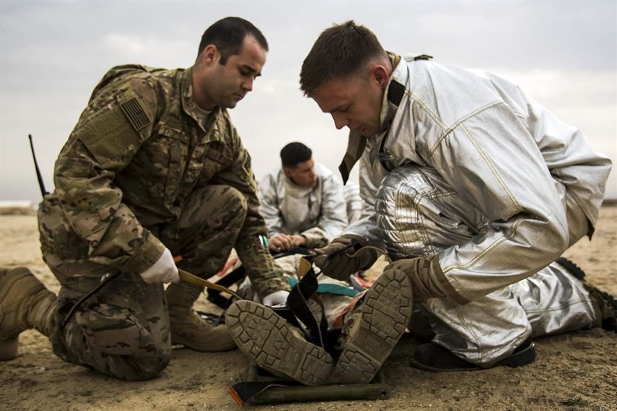 US Air Force medical personnel perform initial triage on a