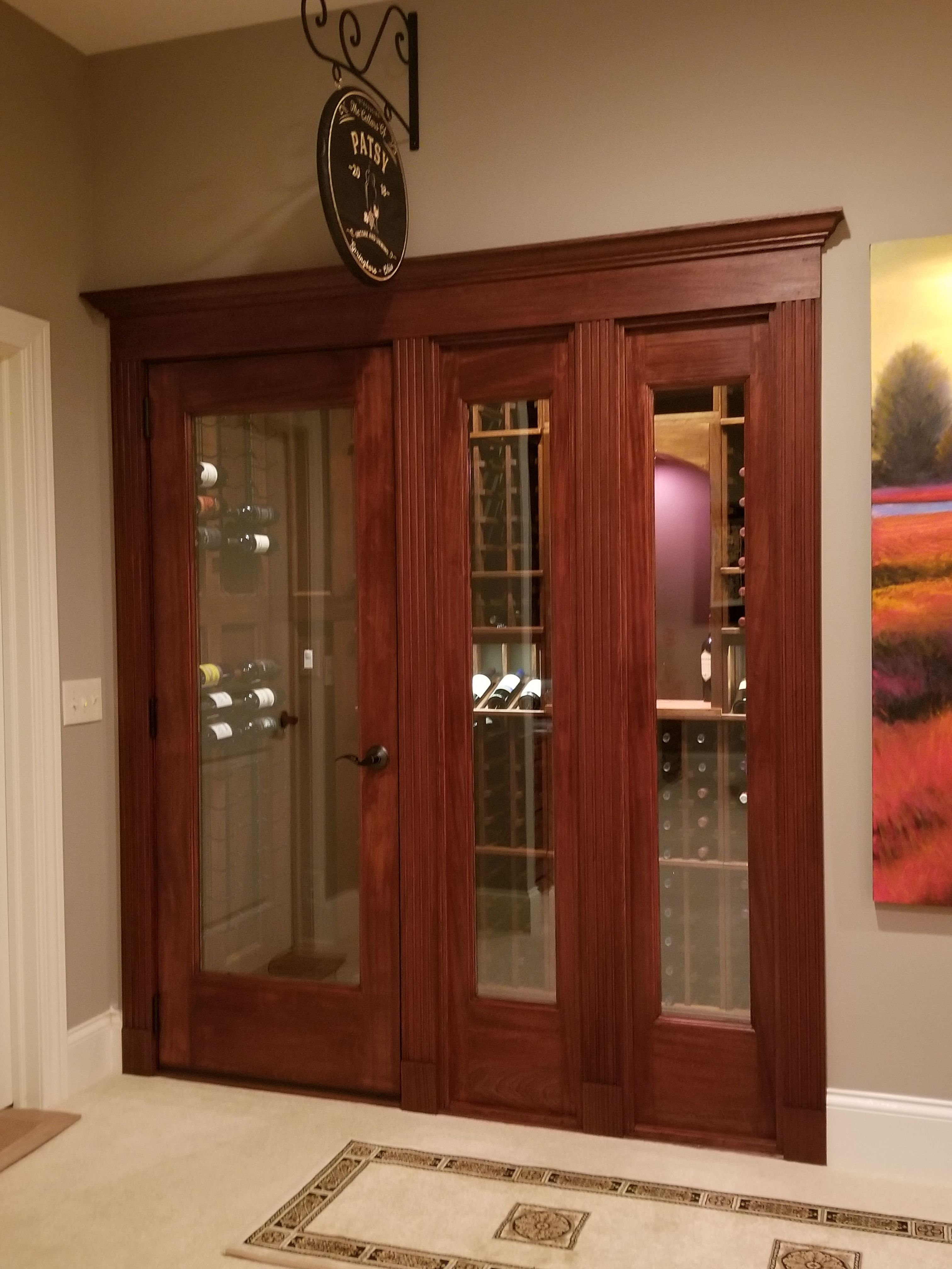 Vigilant full glass square door with sidelights and fluted casings