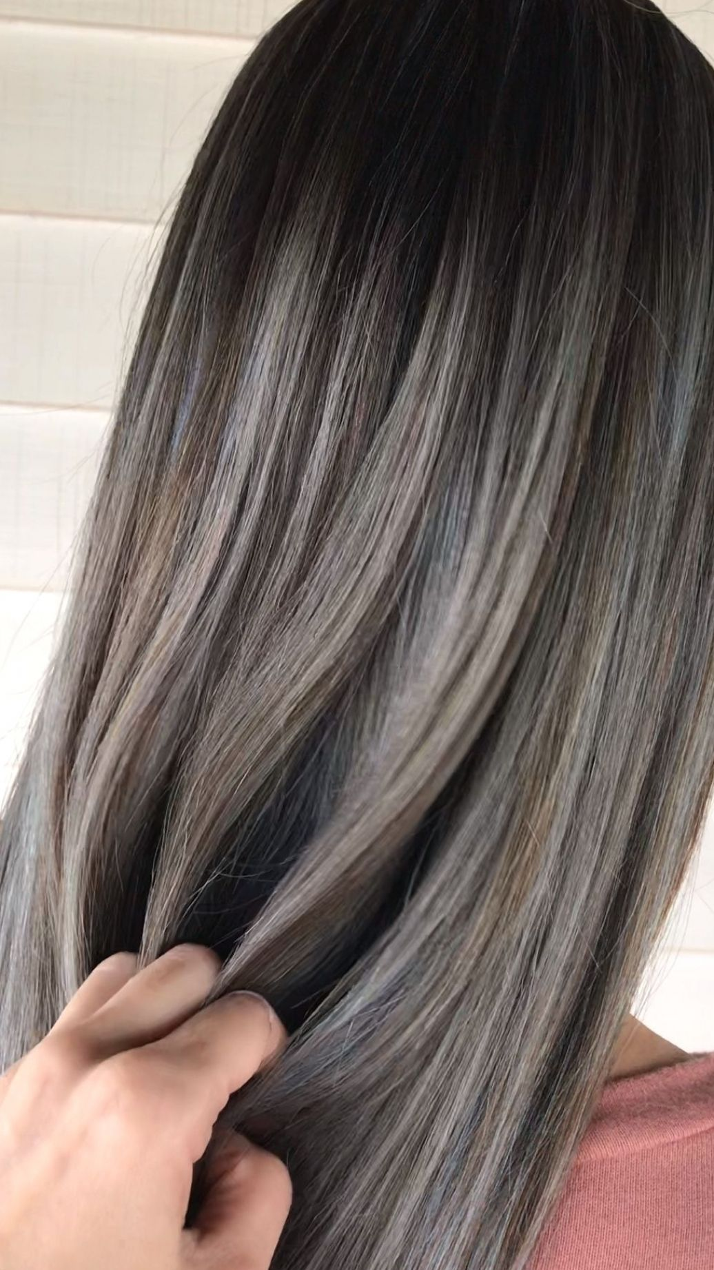 Silver ash blonde balayage on long black hair