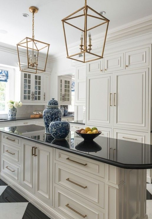 Gorgeous Black And White Kitchen Features White Cabinets Adorned With Antiqued Brass Pulls Alongside White Kitchen Floor Kitchen Inspirations Kitchen Flooring