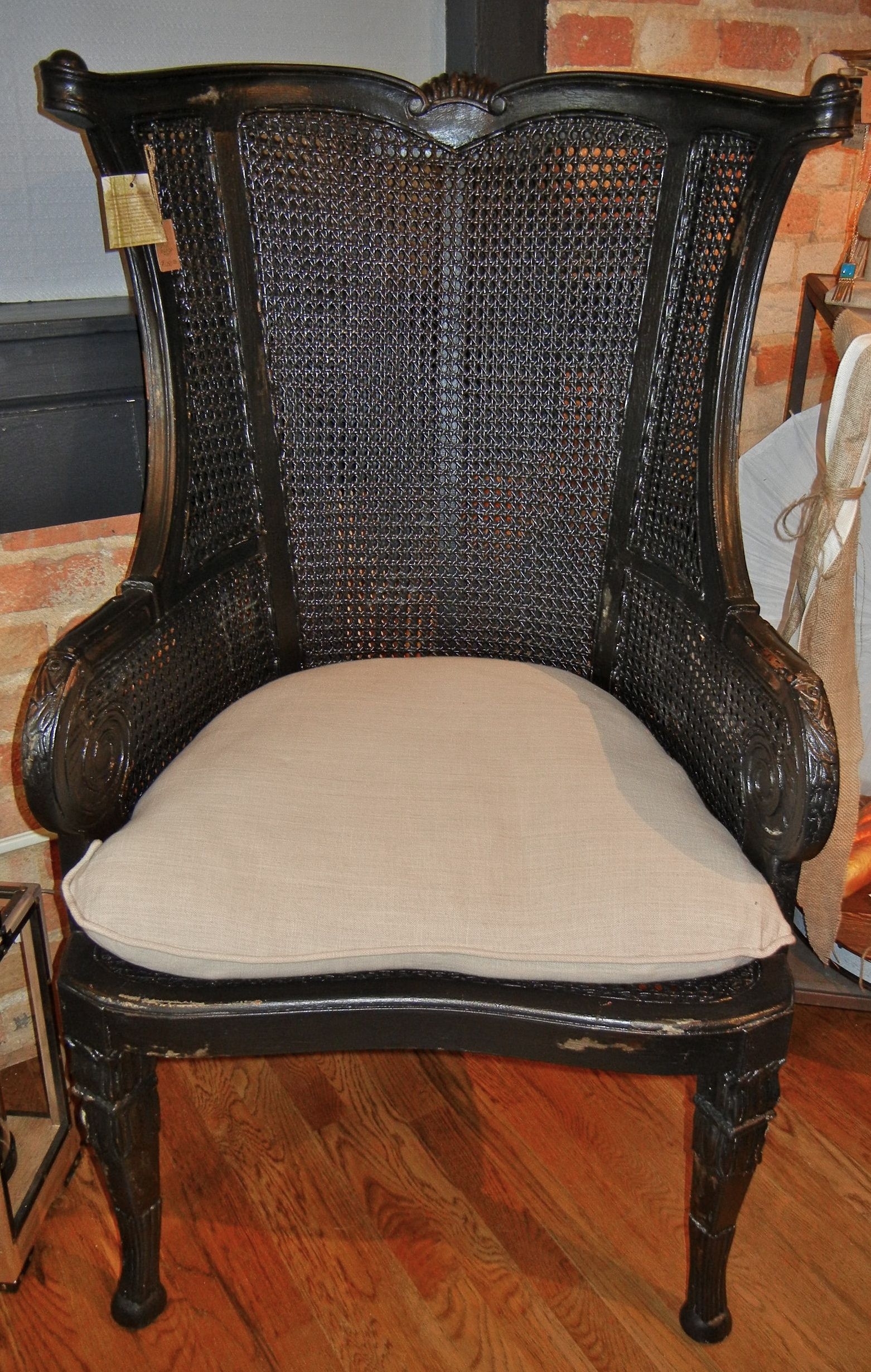 Caned wingback chair by guild master vintage noir finish