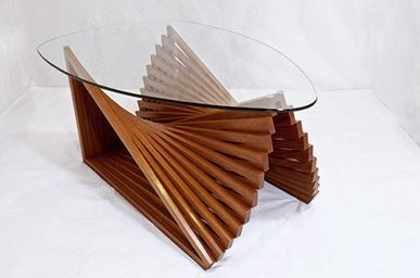 Love this coffee table designed by Justin Richards. If Newton's Laws of Motion, a wave pool, pleated silk and an olympic butterfly swimmer somehow combined into a table. Want in black.
