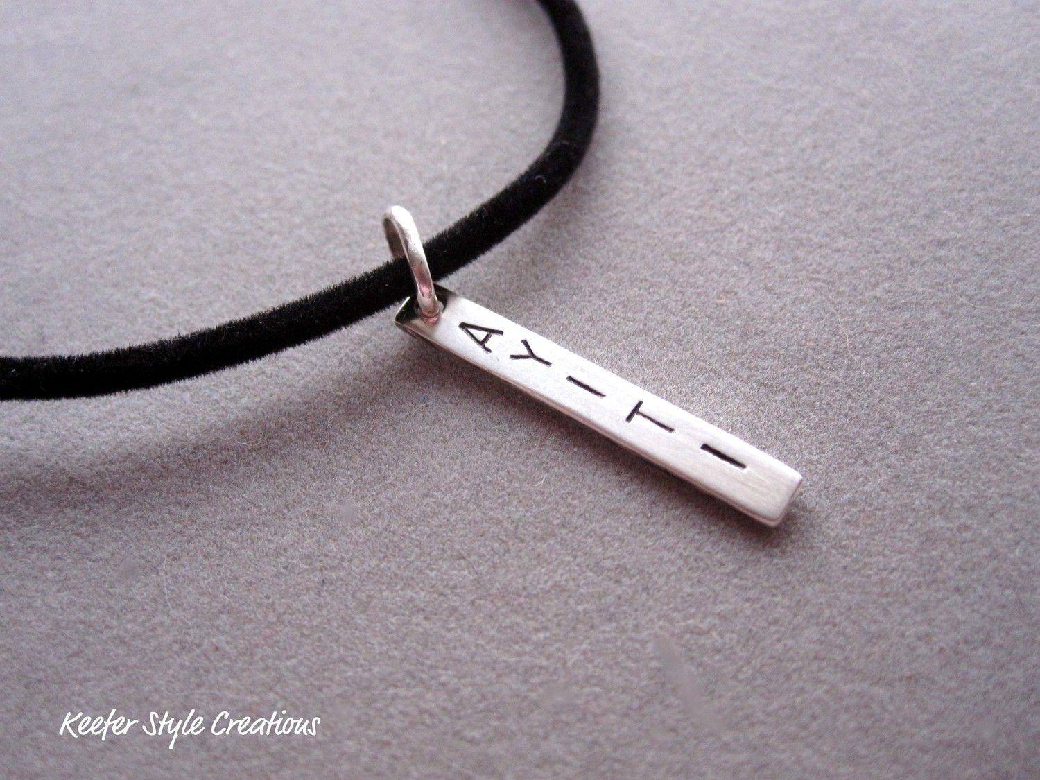 Ayiti haiti handstamped bar necklace on a leather cord