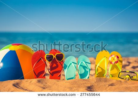 Flip-flops, beach ball and snorkel on the sand. Summer vacation concept - stock photo
