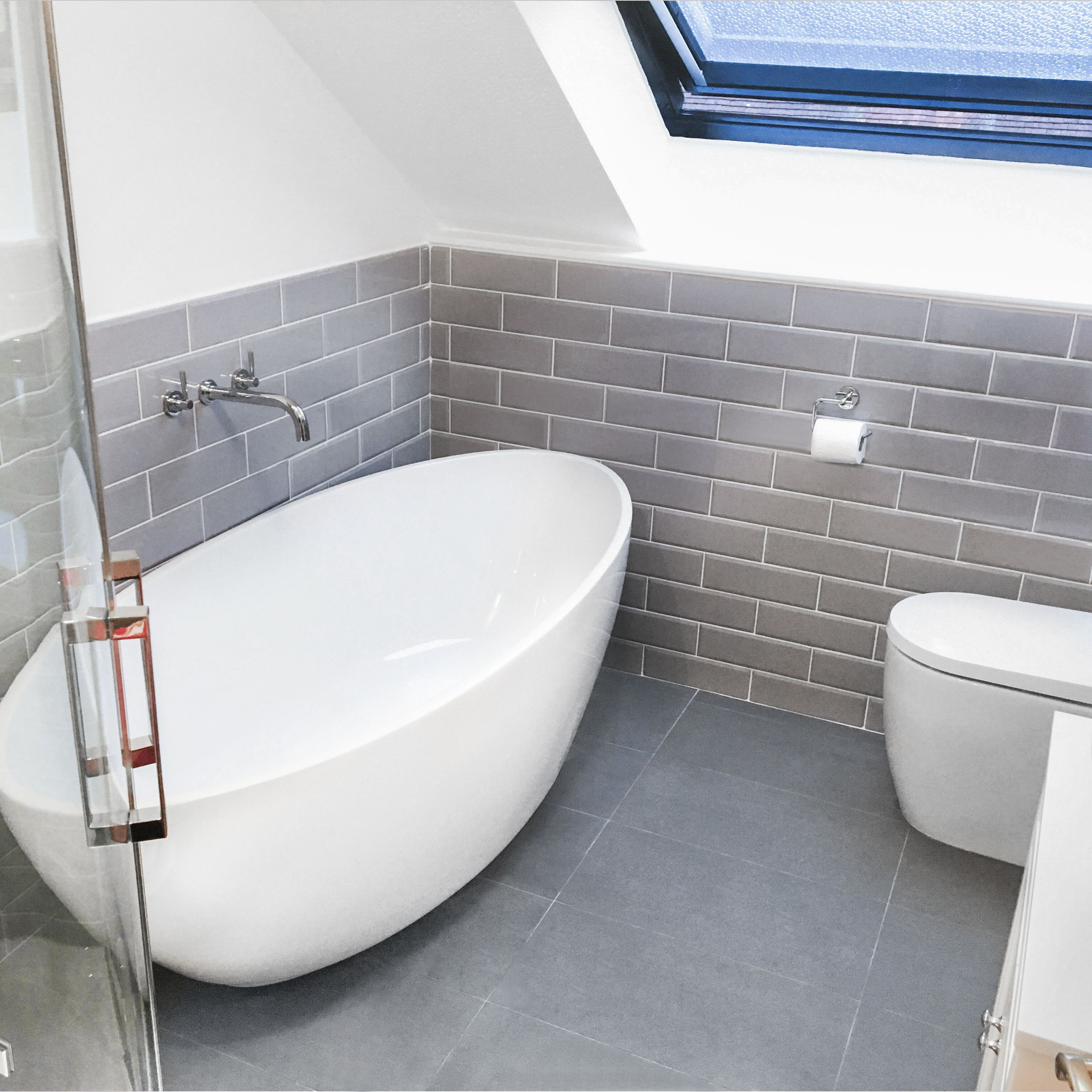 Sleek grey metro tiles perfectly complement the contemporary rounded ...