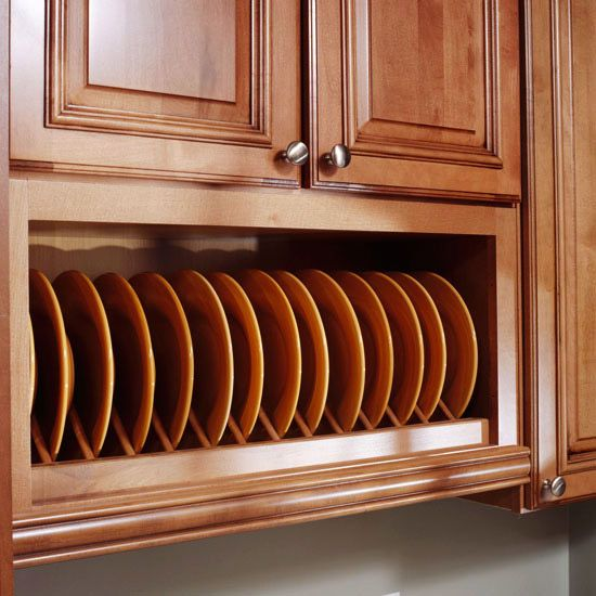 Galley Kitchen - Smart Storage    Maple cabinets with a honey stain and hand-rubbed mocha glaze add warmth to the narrow kitchen and also stay in step with the home's traditional style. This plate rack stores daily-use dishes and the open display of plates adds a splash of color to the space