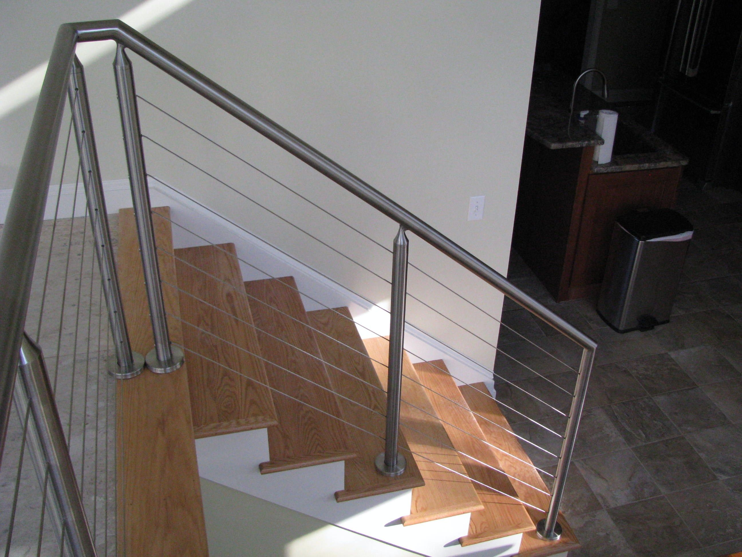 Stainless steel cable railings made with round pipe the railing connections are welded and polished