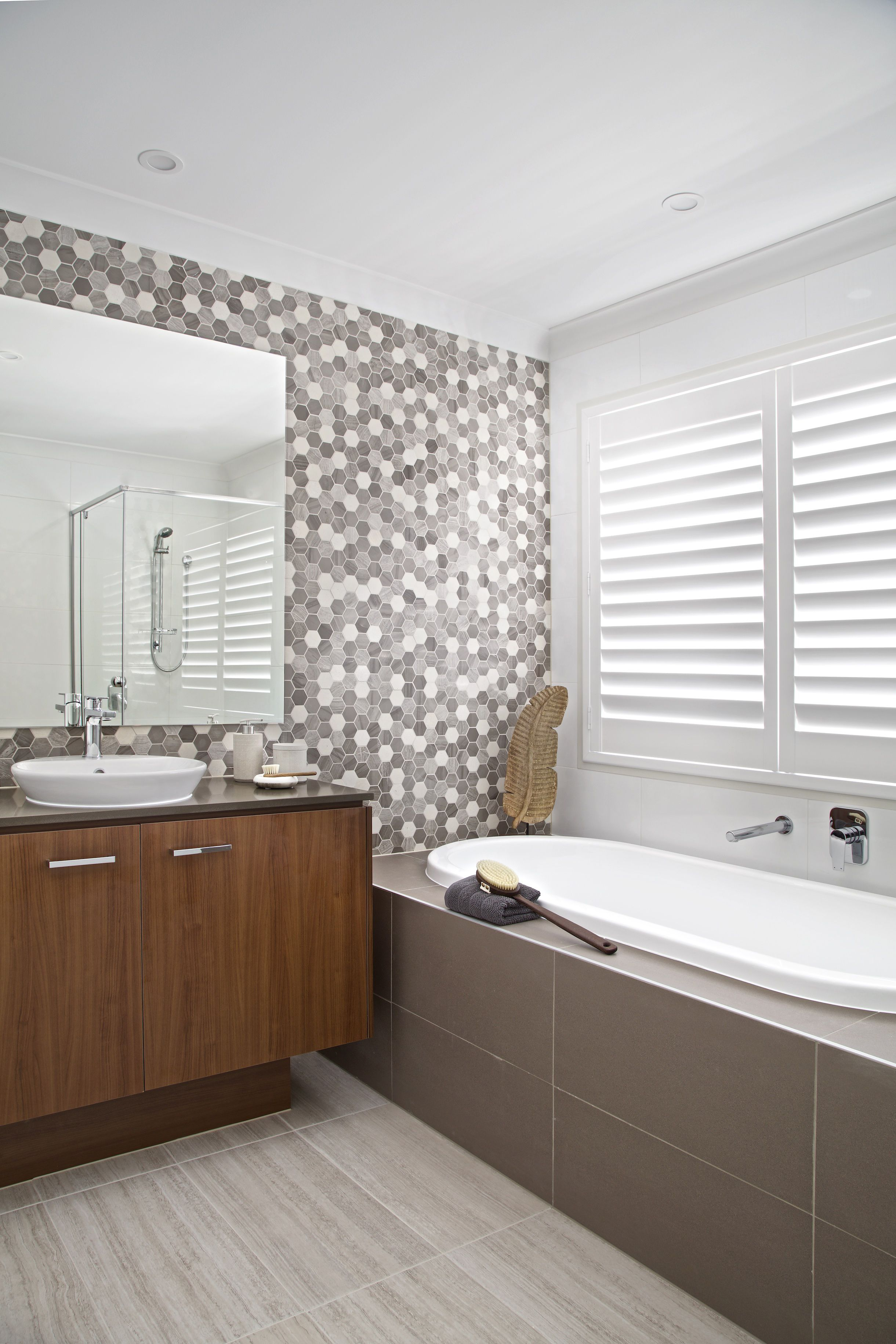 Clarendon Homes. Madison 39. Upstairs main bathroom with multi ...