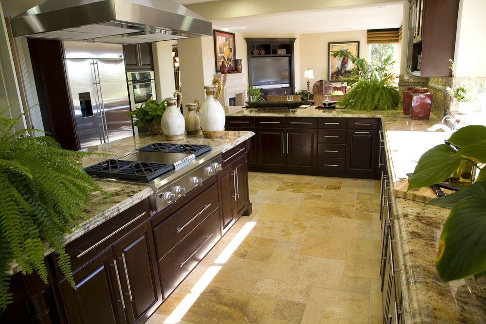 L shaped galley kitchen design with dark wood cabinets for Galley shaped kitchen designs