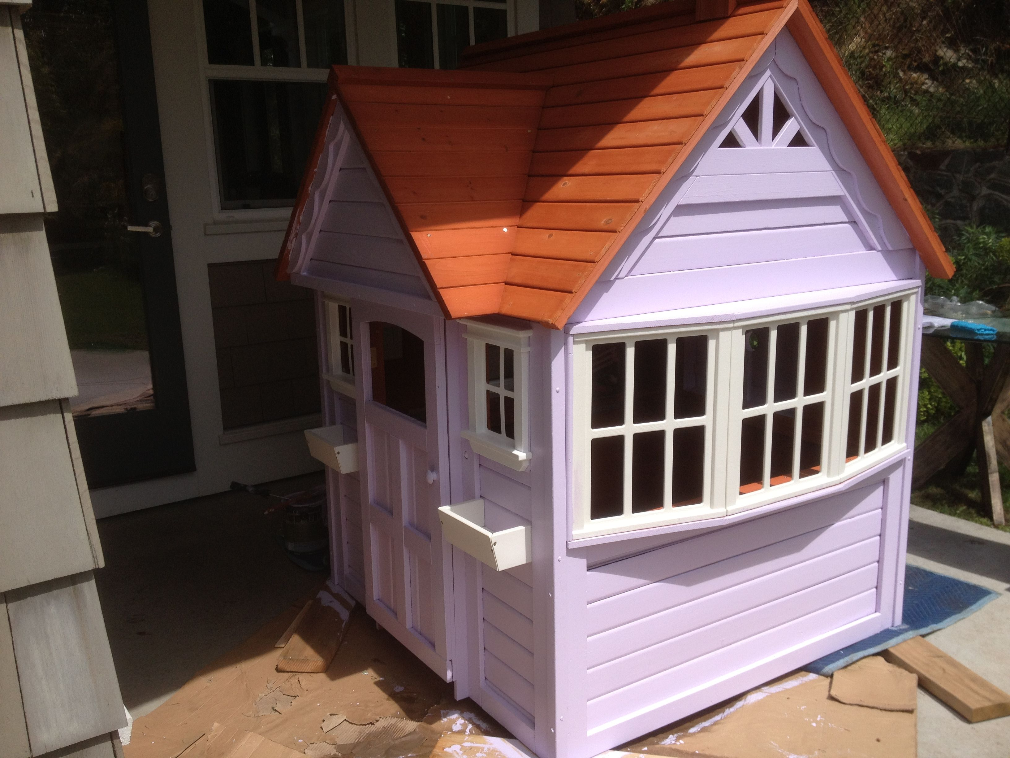 painting a costco playhouse. DIY fix to create a custom look via http://houseandbloom.com/playful-purple-playhouse/