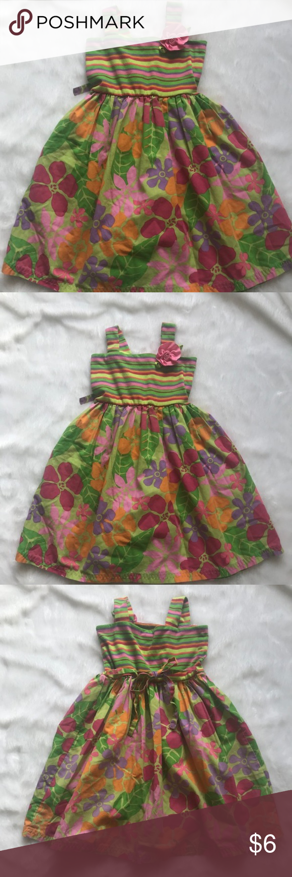 Youngland Island Floral Dress GUC Youngland Island Floral Dress, size 5. Good used condition. The bodice is striped and the skirt has flowers in different shades of pink, purple, and orange against a green background. Rosette on left strap. Ties in back. Some pilling on the bodice as evidenced in the photograph above. Great for summer or a tropical vacation! Bodice: 96% Polyester, 4% Spandex. Skirt: 55% Cotton, 45% Polyester. From a pet-free, smoke-free home. Check out my other little girl cloth