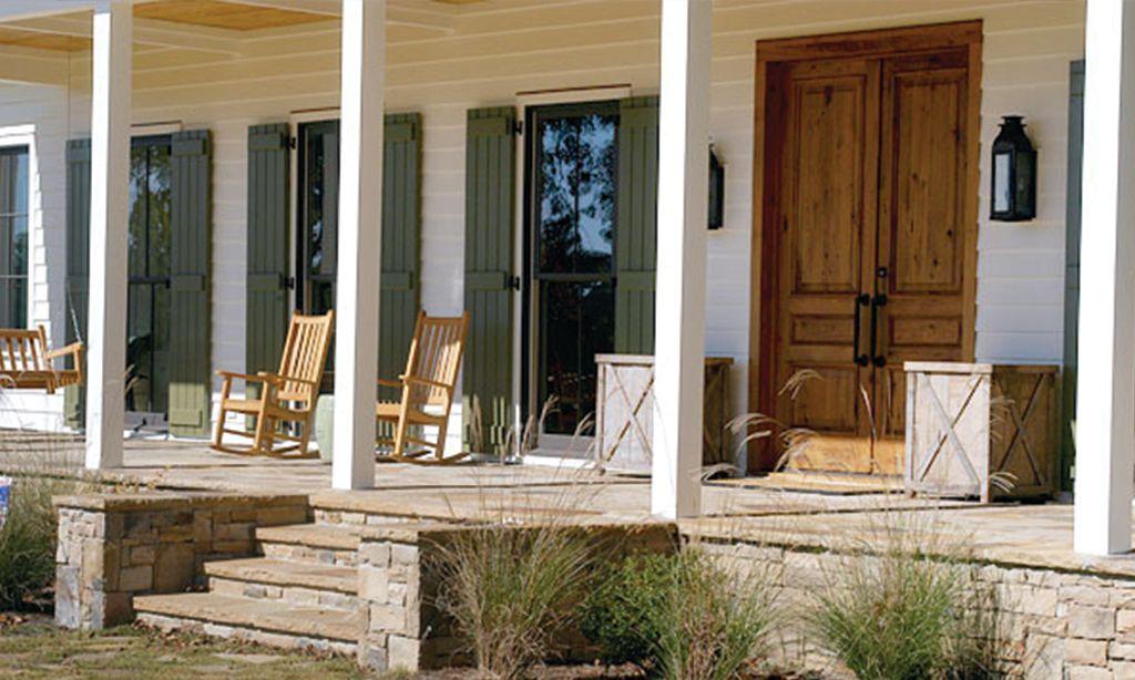 Front porch with rockers and custom door. Outdoor decor