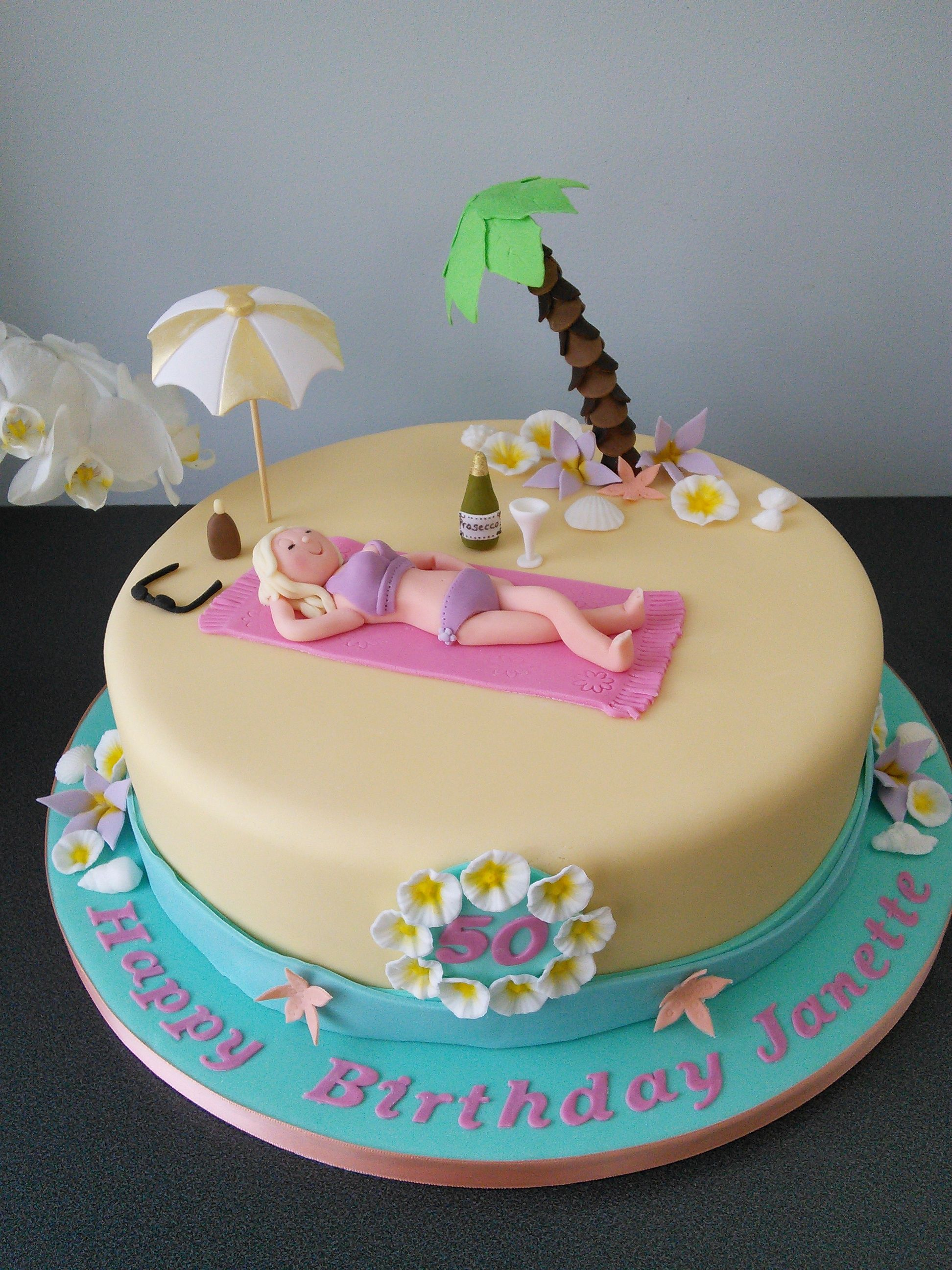Beach cake for 50th birthday, sunbathing, umbrella, palm tree