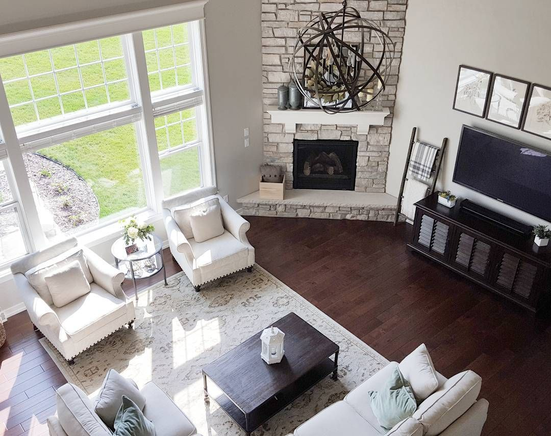 Similar floor plan and corner fireplace to our house Open floor plan living room furniture arrangement