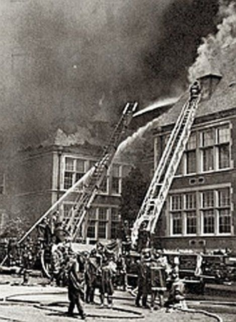 Firefighters trying to control New Rochelle High School fire of 1968.
