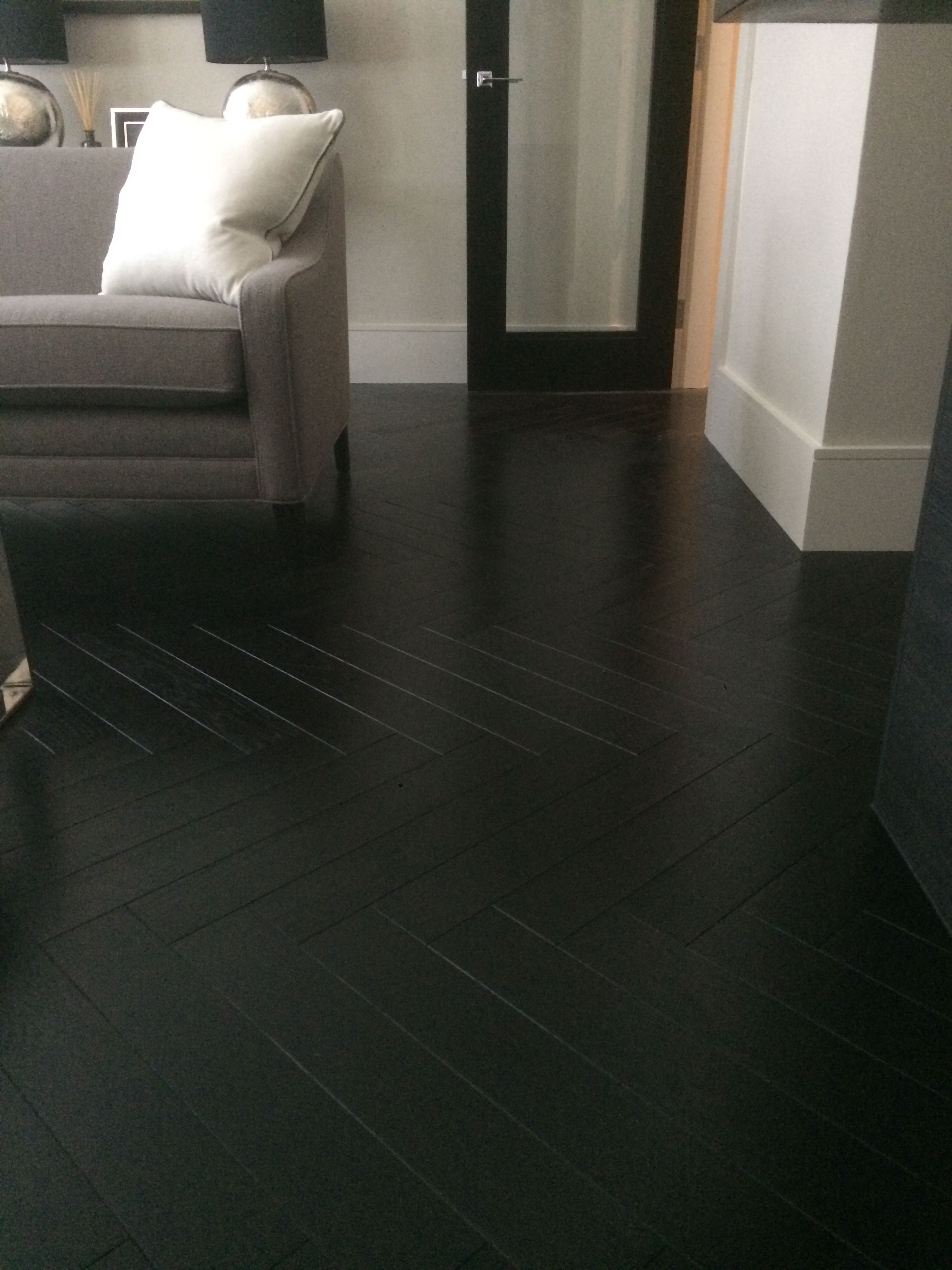 Black Oak Engineered Lacquered Herringbone Laid Over Acoustic Boards In