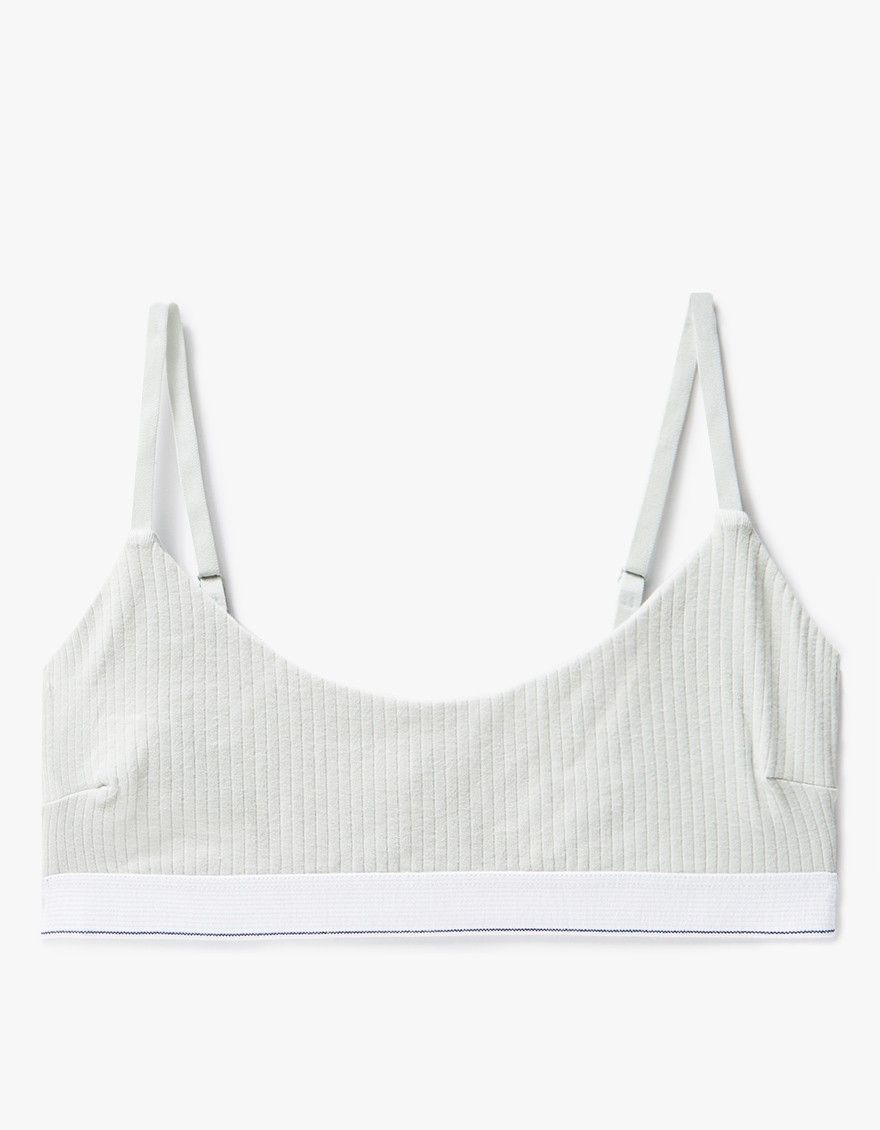 From Baserange, a scoop-neck bralette in Dusty Blue. Adjustable straps. Ribbed. Darts at sides. Thick elastic underband.    • 91% organic cotton 9% elastane • Machine wash cold • Made in Portugal