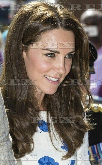 Prince William and Catherine Duchess of Cambridge visit to Luton, UK - 24 Aug 2016  Catherine Duchess of Cambridge receives a posy from 7 year old Evie Farmer at the end of the visit to Keech Hospice to commerate the 25th anniversary. 24 Aug 2016