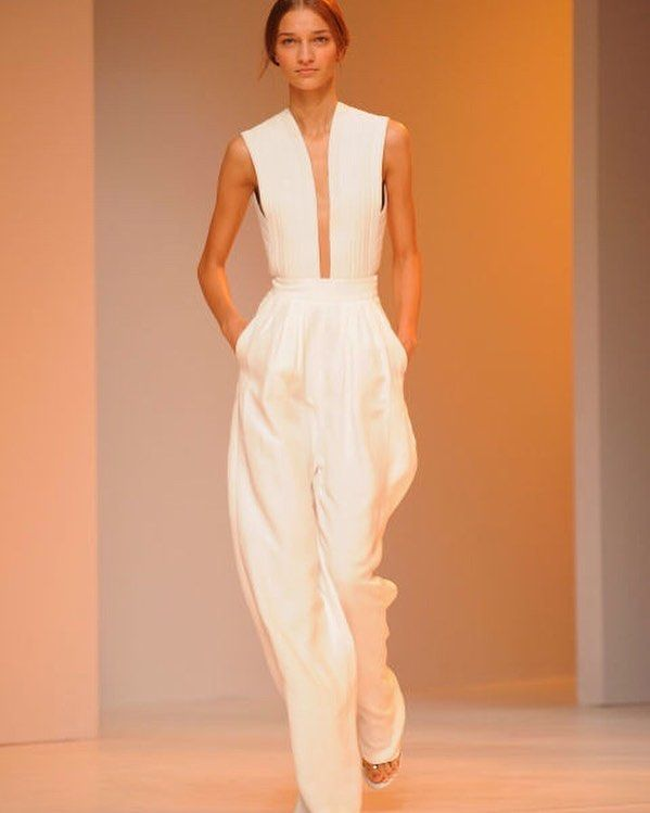 We had to show you this stunning bridal jumpsuit from Porsche Design! We love the jumpsuit trend - it's such a good way to bring fashion into your wedding. Look how fabulous the shape is! by carmelaweddings