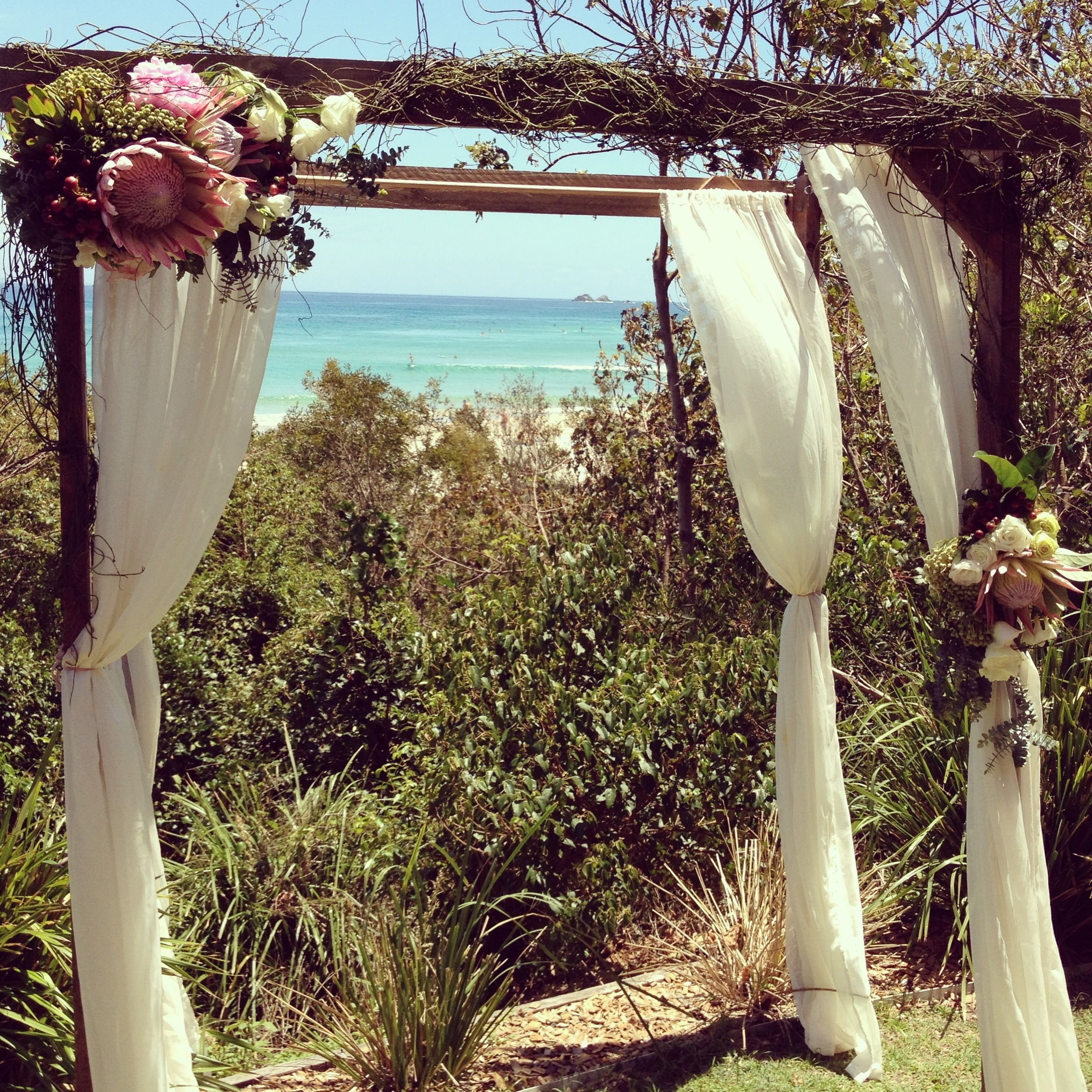 www.beautiflora.com byron bay wedding floral arbour. Using softer flowers for Renee rather than natives