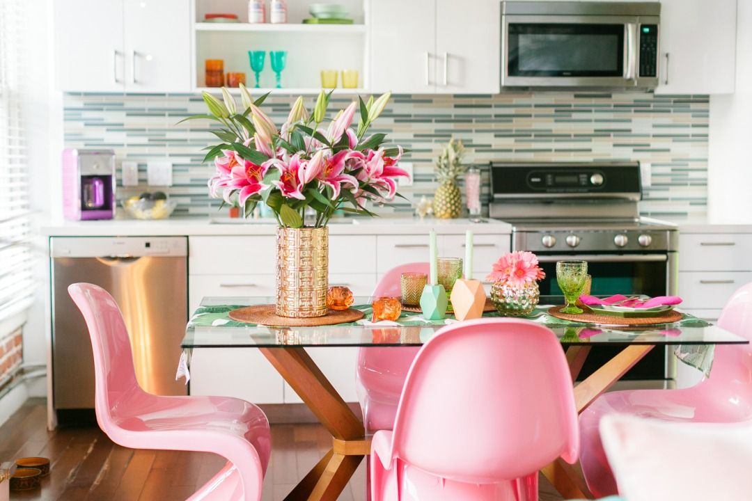Get The Look Colorful Urban Jungle Fantasy Vibes Apartment Makeover Panton Chair Glass Top Dining Table Top tropical dining rooms vibrant