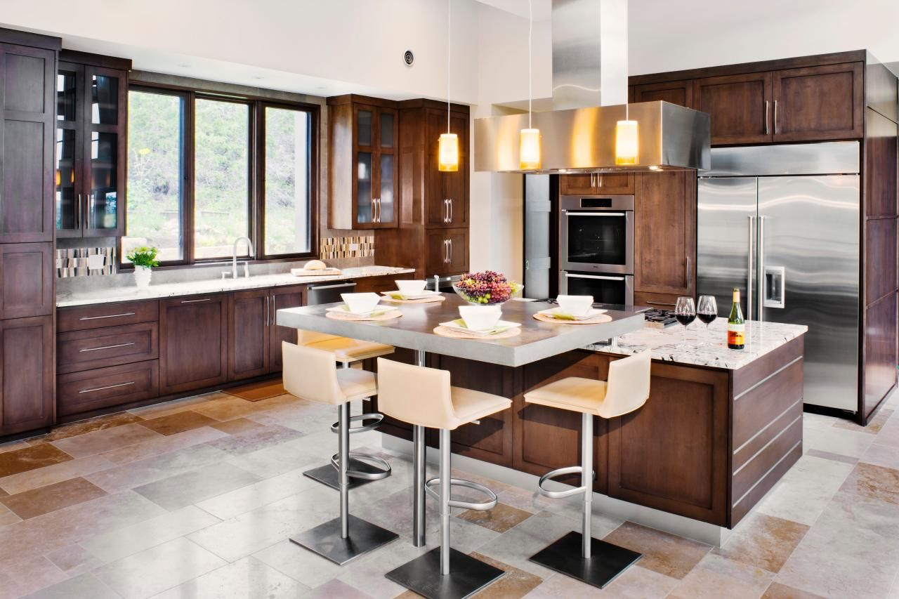 This contemporary kitchen incorporates a caféstyle breakfast island