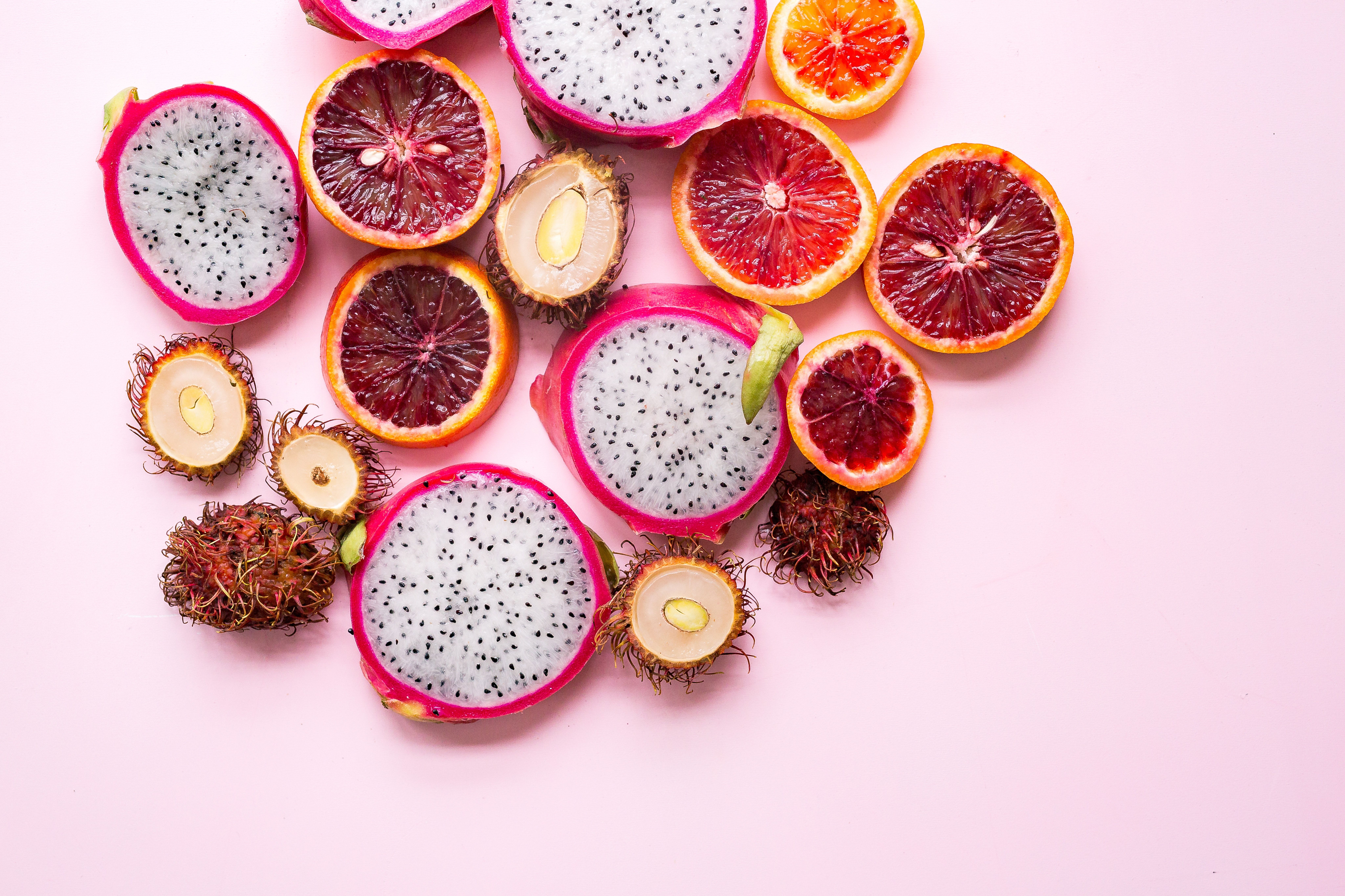 Slices of blood oranges dragon fruit and tropical fruit kitchen