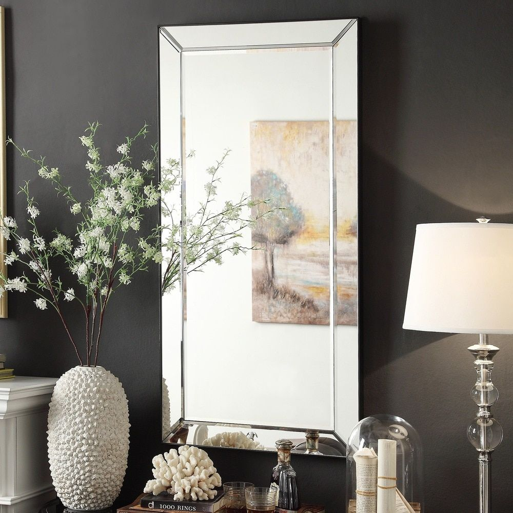 Add a bit of glam to your entryway or bathroom with this gorgeous beveled  mirror.