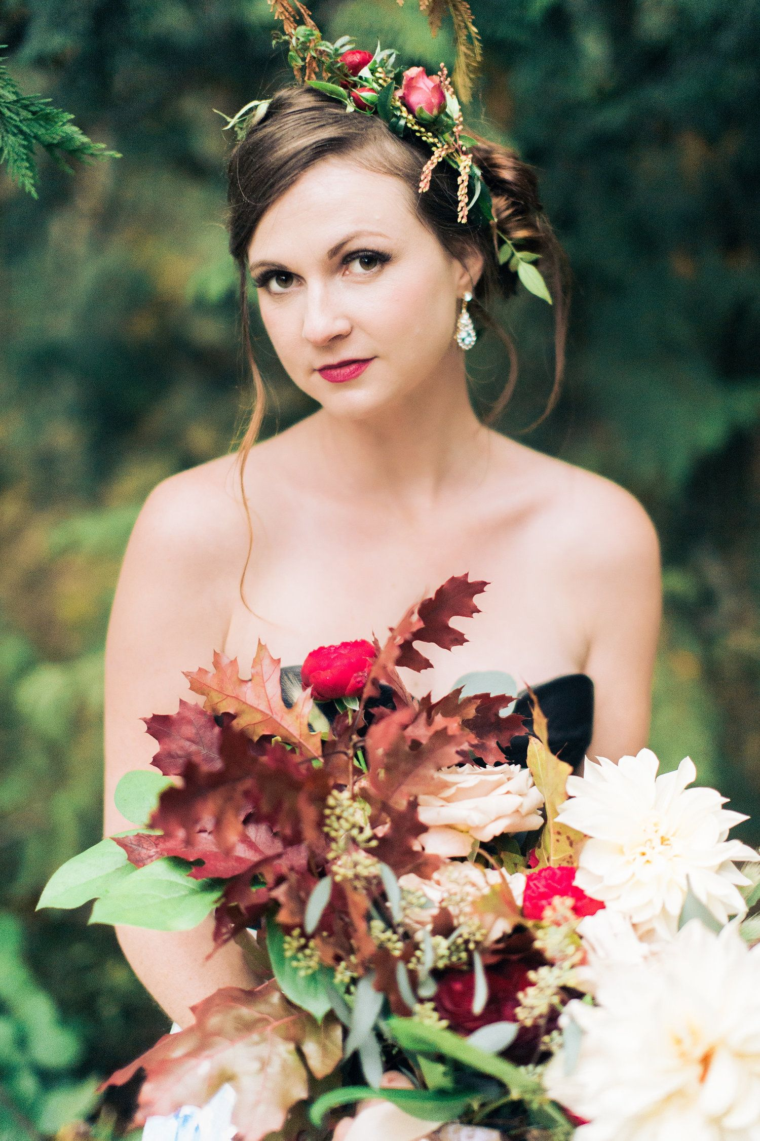 Dress by Clare La Faye. Photo: CJK visuals. Flowers: Studio 3 Floral