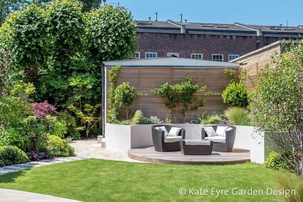 Medium Sized Back Garden Design In Wandsworth 1