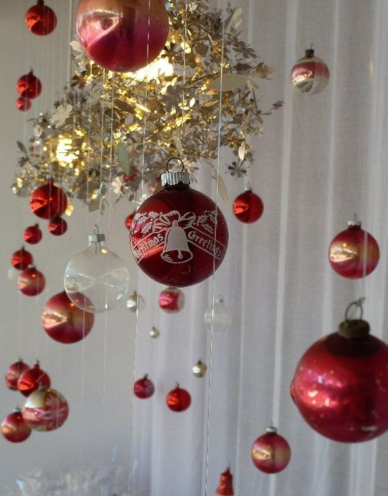 Christmas Ornaments Hanging From Chandelier Or Ceiling